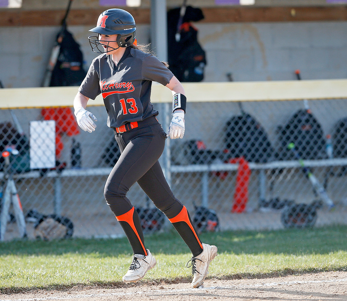 Tori Boysen (13) from McHenry heads to the plate after hitting a home run during the third inning of their game at Wauconda High School on Friday, April 7, 2017 in Wauconda. The Warriors defeated the Bulldogs 7-6. John Konstantaras photo for the Northwest Herald