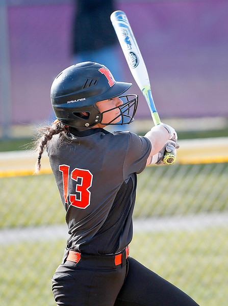 Tori Boysen (13) from McHenry hits a home run during the third inning of their game against Wauconda at Wauconda High School on Friday, April 7, 2017 in Wauconda. The Warriors defeated the Bulldogs 7-6. John Konstantaras photo for the Northwest Herald