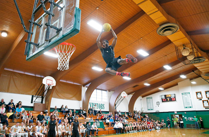 Alonzo Steen with Chicago Sky Squad entertains the crowd as he goes above the rim using a mini trampoline during the halftime of the Boys all-star basketball game at Alden-Hebron High School on Sunday, April 9, 2017 in Hebron, Ill. The away team won the game 87-86.  John Konstantaras photo for the Northwest Herald