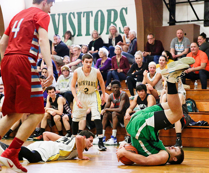 Harvard's Roy Amaya Jr. (20) watches as Alden-Hebron's Taylor Glenn grabs the ball as he rolls  during the first half of the Boys all-star basketball game at Alden-Hebron High School on Sunday, April 9, 2017 in Hebron, Ill. The away team won the game 87-86.  John Konstantaras photo for the Northwest Herald