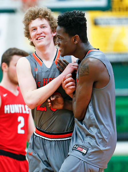 Away team members McHenry's Matthew Mohr (right) celebrates with teammate Colton Klein after he hit a last minute shot before halftime during the first half of the Boys all-star basketball game at Alden-Hebron High School on Sunday, April 9, 2017 in Hebron, Ill. The Away team won the game 87-86.  John Konstantaras photo for the Northwest Herald