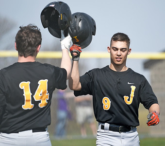 Jacobs senior Mike Anddante (cq) is congratulated for hitting a homer by teammate Ian Oreskovich Saturday, April 15, 2017 at Hampshire High School. Anddante hit two home runs during the five-inning game.