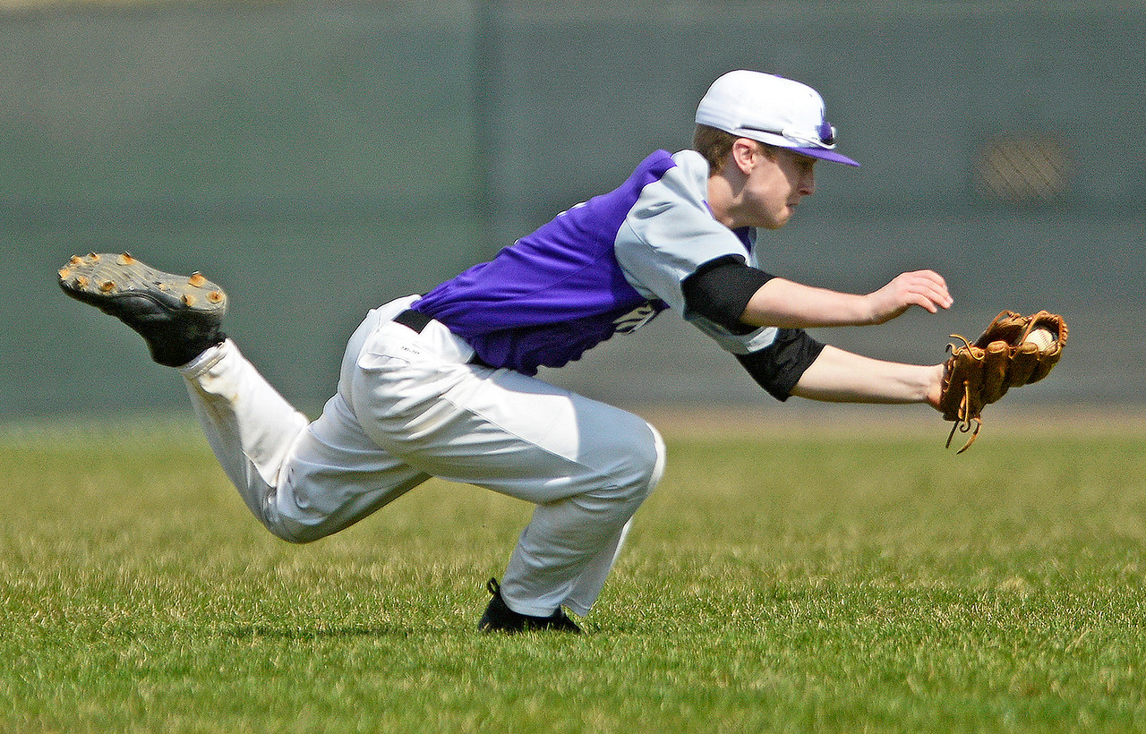 Hampshire's Kevin Michaelsen catches a fly ball Saturday, April 15, 2017. Michaelsen summersaulted after the catch and maintained control of the ball to make the out.