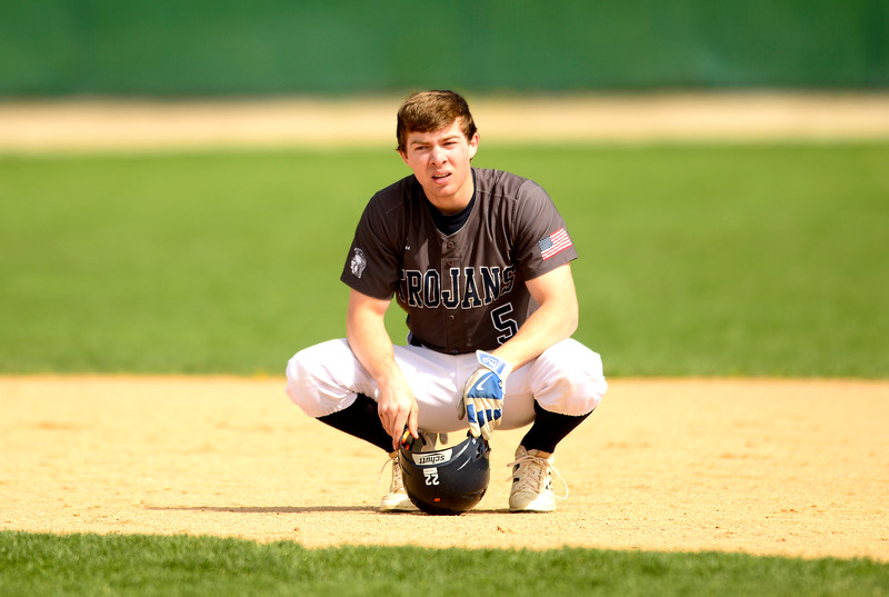 Kayla Wolf for Shaw Media- Cary-Grove senior Zach Willis kneels in disbelief Saturday April 22, 2017, as the first base umpire called a teammate out, leading to the third and final out of the inning. The Dundee Crown Chargers won 12 to 3.
