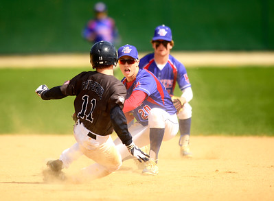 Kayla Wolf for Shaw Media- Dundee Crown senior Jack Waldron tags out Cary-Grove's Tristan Atkins Saturday April 22, 2017, as he attempts to steal second base. Dundee Crown won 12 to 3.