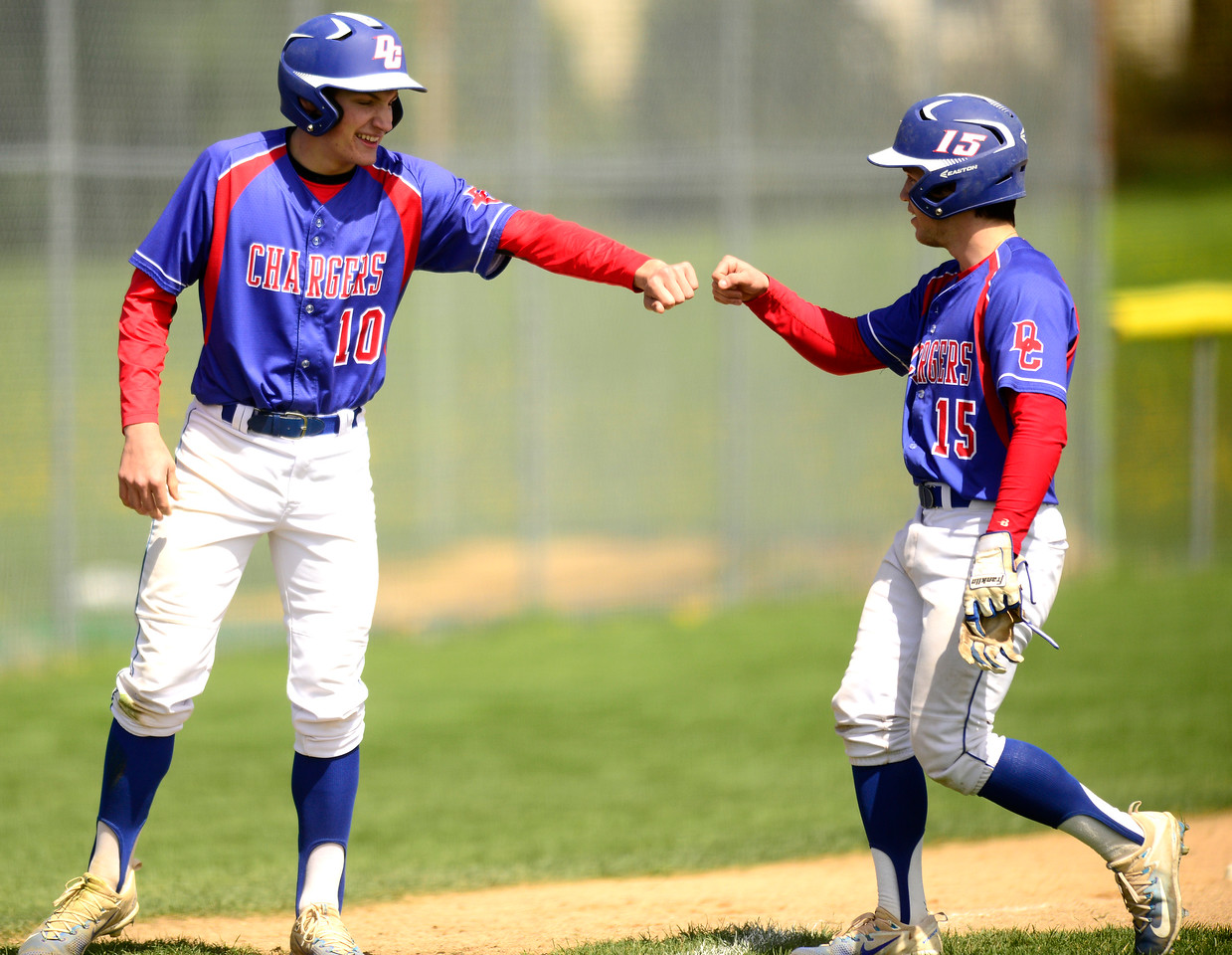 Kayla Wolf for Shaw Media- Dundee Crown's Conor Ryan (left) congradulates Jonathan Mays (right) for hitting a deep ball to left field Saturday April 22, 2017, during a game at Cary-Grove. Dundee Crown won 12 to 3.