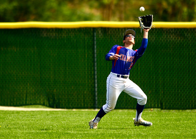 Kayla Wolf for Shaw Media- Dundee Crown senior Scott Wojcik catches a fly ball Saturday April 22, 2017, during a game at Cary-Grove High School. Dundee Crown won 12 to 3.