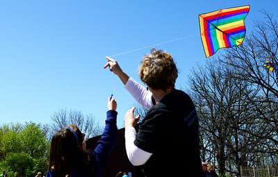Kayla Wolf for Shaw Media- Marvin's Toy Store owner Lori McConville (right) helps Ainhoa Benito get a kite into the air during an Earth Day celebration Saturday, April 22, 2017, at Prairieview Education Center in Crystal Lake. Marvin's Toy Store in Crystal Lake researches the environmental, social and shipping practices that toy producers use, to ensure that the toys they offer to their customers can feel good about their purchases.