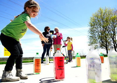 Kayla Wolf for Shaw Media- Hazel Greenlee tosses a ring around a reused plastic bottle in a game about bird conservation Saturday April 22, 2017, at the Earth Day celebration held at Prairieview Education Center. The District and the Environmental Defenders of McHenry County co-hosted the event.