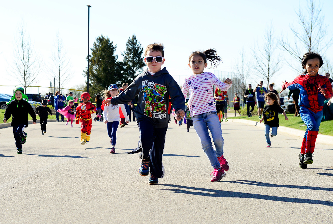 Kayla Wolf for Shaw Media- Toddler Joey Spatz, 4, (center) leads the way to the finish line during a toddler race Sunday, April 23, 2017, during the events of  the McHenry County Human Race. Seven hundred and fifty runners participated and over 70 local charities received donations.