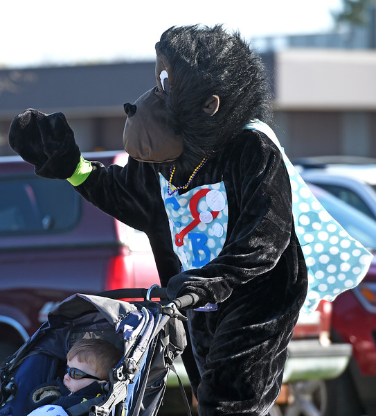 Kayla Wolf for Shaw Media- Runner Andy Fry waves at people cheering him on as he pushes his son Henry Fry in a stroller Sunday, April 23, 2017, at the McHenry County Human Race.