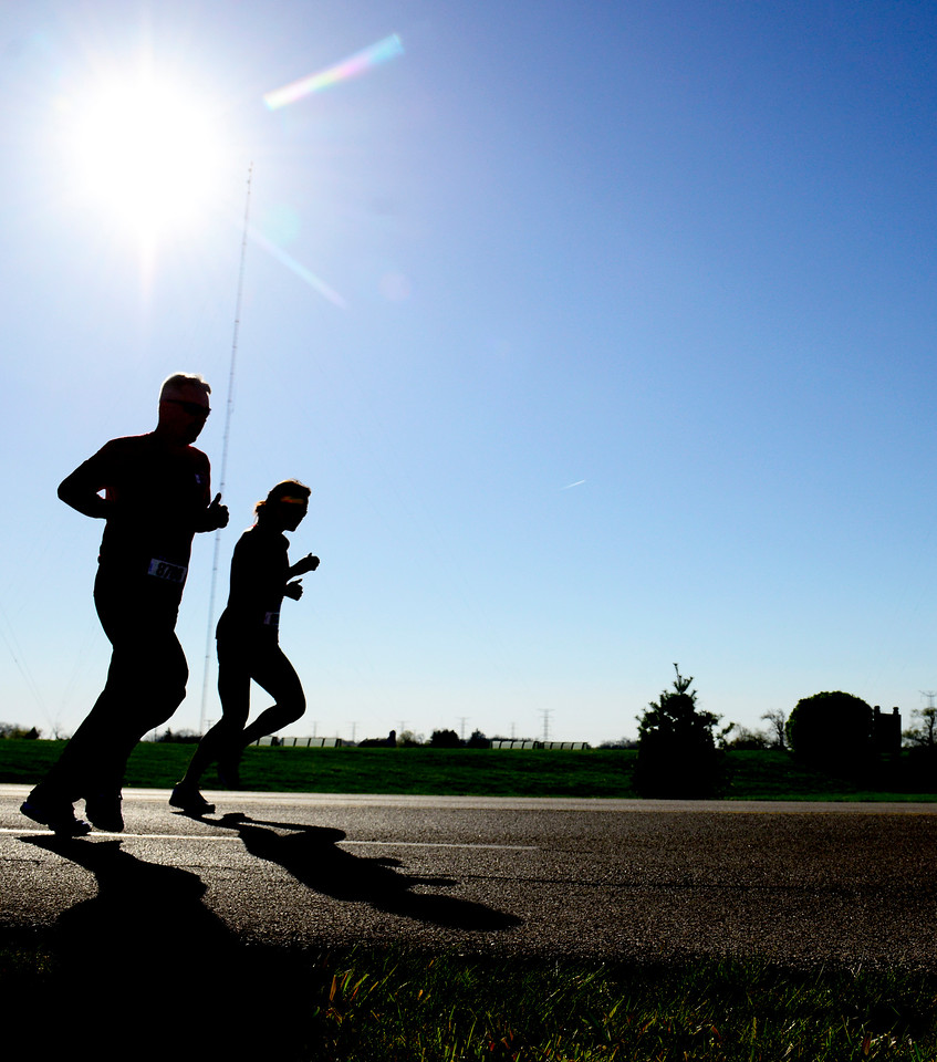 Kayla Wolf for Shaw Media- Runners Eric Barham (left) and Melanie Pilat compete in the McHenry County Human Race a 5K run walk that benefits many local charities. Pilat was the first female to finish the race in a time of 21 minutes and 53.7 seconds.