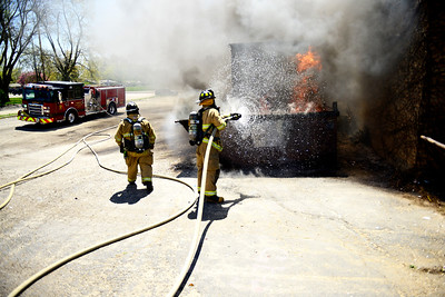 Kayla Wolf for Shaw Media- The Huntley Fire Department puts out a dumpster fire Sunday, April 23, 2017, behind Bowl-Hi Lanes in Huntley. The dumpster belonged to Sweet Repeats, a resale shop located next to the bowling alley and contained old furniture and garbage.