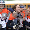 Oswego's Becky Pieroni gets hugs and cheers from her teammates after hitting in the game winning run in extra innings against Plainfield North during a varsity softball game at Oswego High School on Friday, April 28, 2017.<br /> Steve Buyansky for Shaw Media