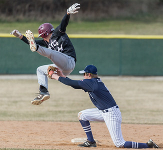 Prairie Ridge's, Nick Sargeant, tries to hurdle the tag from Cary-Grove's Jacob MacDuff Monday, April 2, 2018 in Cary. Prairie Ridge went on to win the game 6-5 in the extra-inning game.  KKoontz- For Shaw Media