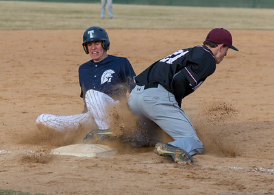 Cary-Grove baserunner Shane Layshock slides in before the tag at third Monday, April 2, 2018 in Cary. Prairie Ridge went on to win the game 6-5 in the extra-inning game. KKoontz- For Shaw Media