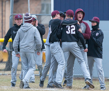Prairie Ridge teammates celebrate their 6-5 extra-inning win over Cary-Grove Monday, April 2, 2018 in Cary.  KKoontz- For Shaw Media