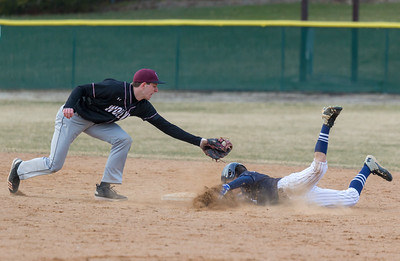 Cary Grove's Steven Calamari slides under the tag of Prairie Ridge shortstop Roth Mizell Monday, April 2, 2018 in Cary. Prairie Ridge went on to win the game 6-5 in the extra-inning game. KKoontz- For Shaw Media