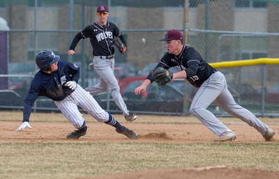 Cary-Grove third baseman, Kyle Ives, avoids the tag by Prairie Ridge pitcher, Joseph Hansen, Monday, April 2, 2018 in Cary. Prairie Ridge went on to win the game 6-5 in the extra-inning game.  KKoontz- For Shaw Media
