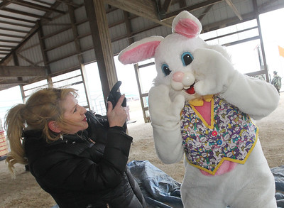 Candace H. Johnson-For Shaw Media Christine Kubiak, of Grayslake dances with the Easter bunny after the Re/Max Center's Easter Egg Hunt at the Lake County Fairgrounds in Grayslake.Kubiak is a broker associate with the Re/Max Center.(3/31/18)