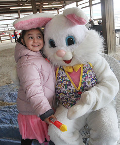 Candace H. Johnson-For Shaw Media Victoria Fajardo, 6, of Zion visits with the Easter bunny during the Re/Max Center's Easter Egg Hunt at the Lake County Fairgrounds in Grayslake.(3/31/18)