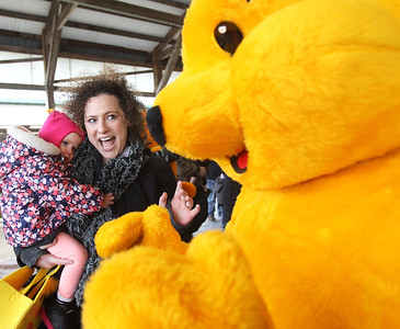 "Candace H. Johnson-For Shaw Media Emma Erickson, twenty-months-old, of Grayslake and her mother, Stephanie, say, ""hello,"" to Winnie the Pooh during the Re/Max Center's Easter Egg Hunt at the Lake County Fairgrounds in Grayslake.(3/31/18)"