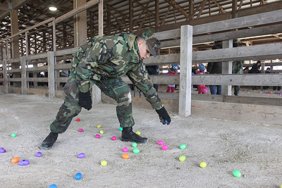 Candace H. Johnson-For Shaw Media Joseph Stapleton, 15, of Gurnee with the Lake County Young Marines helps to distribute Easter eggs during the Re/Max Center's Easter Egg Hunt at the Lake County Fairgrounds in Grayslake.(3/31/18)
