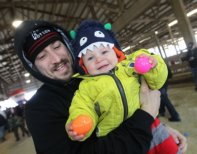 Candace H. Johnson-For Shaw Media Michael Mazurkiewicz, of Round Lake holds his son, Darek, 1, after he picked up some Easter eggs during the Re/Max Center's Easter Egg Hunt at the Lake County Fairgrounds in Grayslake.Darek's mother, Olivia, was also at the event with them.(3/31/18)