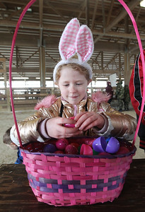 Candace H. Johnson-For Shaw Media Bella VanHorn, 7, of Round Lake goes through the Easter eggs she picked up to look for a prize slip during the Re/Max Center's Easter Egg Hunt at the Lake County Fairgrounds in Grayslake.(3/31/18)