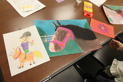 Candace H. Johnson-For Shaw Media Art by Mya Hamelberg, 8, of Antioch is ready to take home during the Horses Art Camp at the Hunt Club Community Center in Gurnee.