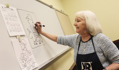 Candace H. Johnson-For Shaw Media Susan Noon, of Lindenhurst, a Young Rembrandts art teacher, teaches students ages 6-13 how to make a cartoon during the Horses Art Camp at the Hunt Club Community Center in Gurnee.(3/30/18)
