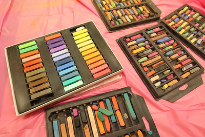 Candace H. Johnson-For Shaw Media Boxes of new and old pastels are on the table for kids to use to color their horse drawing during the Horses Art Camp at the Hunt Club Community Center in Gurnee.