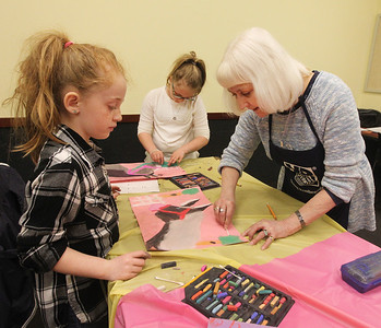 Candace H. Johnson-For Shaw Media Eden Hamelberg, 8, of Antioch gets some help from Susan Noon, of Lindenhurst, a Young Rembrandts art teacher, blending in her pastels as she makes a horse drawing with her sister, Mya, 10, (in the middle) coloring beside her during the Horses Art Camp at the Hunt Club Community Center in Gurnee. (3/30/18)