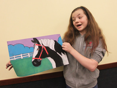 Candace H. Johnson-For Shaw Media Landry Lies, 10, of Gurnee talks about the horse drawing she made using pastels during the Horses Art Camp at the Hunt Club Community Center in Gurnee.(3/30/18)