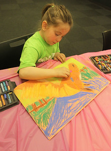 Candace H. Johnson-For Shaw Media Logan Szostak, 6, of Gurnee works on her pastel drawing of a horse during the Horses Art Camp at the Hunt Club Community Center in Gurnee.