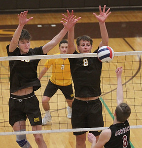 Candace H. Johnson-For Shaw Media Carmel's Mike Scott and Jackson Ptasienski look to block a tip by Antioch's Connor Flatley in the second set at Carmel Catholic High School in Mundelein. Carmel won 25-13, 25-12.(4/3/18)