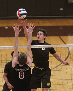 Candace H. Johnson-For Shaw Media Carmel's Jackson Ptasienski (on right) tips the ball past Antioch's Connor Flatley in the second set at Carmel Catholic High School in Mundelein. Carmel won 25-13, 25-12.(4/3/18)