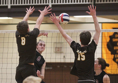 Candace H. Johnson-For Shaw Media Antioch's Connor Flatley (#8) makes an attack against Carmel's Jackson Ptasienski and Mike Scott in the first set at Carmel Catholic High School in Mundelein. Carmel won 25-13, 25-12. (4/3/18)