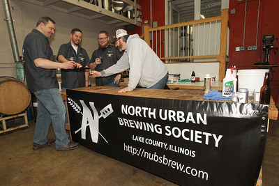Candace H. Johnson-For Shaw Media Dan Berger, of Libertyville, Trevor Patric, of Volo, Matt King, of Mundelein and Andy Denton, of Island Lake, members of the North Urban Brewing Society, drink some home brewed IPA at Perfect Brewing Supply in Libertyville.(4/3/18)