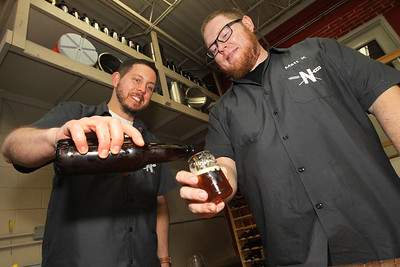 Candace H. Johnson-For Shaw Media North Urban Brewing Society members Trevor Patric, of Volo pours Matt King, of Mundelein a home brewed beer at Perfect Brewing Supply in Libertyville.(4/3/18)