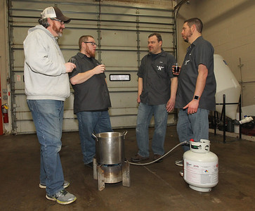 Candace H. Johnson-For Shaw Media North Urban Brewing Society members Andy Denton, of Island Lake, Matt King, of Mundelein, Dan Berger, of Libertyville and Trevor Patric, of Volo stand next to a brew kettle as they brew beer at Perfect Brewing Supply in Libertyville.(4/3/18)