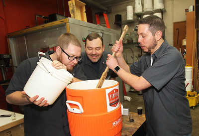 Candace H. Johnson-For Shaw Media North Urban Brewing Society members Matt King, of Mundelein, Dan Berger, of Libertyville and Trevor Patric, of Volo work on preparing mash during the brewing process of making beer at Perfect Brewing Supply in Libertyville.(4/3/18)