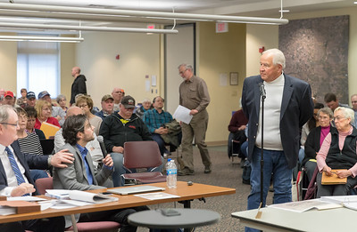 Kenneth Lindy from McHenry asks questions during the McHenry County Zoning Board of Appeals meeting Thursday, April 5, 2018 in Woodstock. A large number of area residents were in attendance voicing their concerns over a proposed solar farm complex to be built on Ringwood Road. KKoontz- For Shaw Media