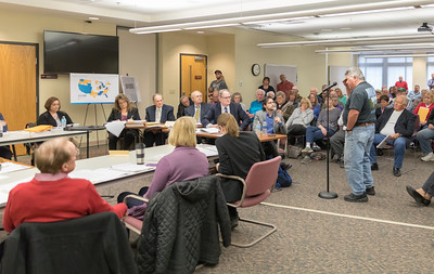 Randall Vendegna from McHenry asks questions during the McHenry County Zoning Board of Appeals meeting Thursday, April 5, 2018 in Woodstock. A large number of area residents were in attendance voicing their concerns over a proposed solar farm complex to be built on Ringwood Road. KKoontz- For Shaw Media