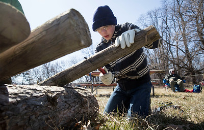 Tenderfoot Boy Scout Kevin Riley, 12, from Woodstock, with Troop 153, saws a log in the Axe Area during the third annual Scouting Around at Colonel Palmer House on Saturday, April 7, 2018 in Crystal Lake, Illinois. The program is a free annual event run by the Crystal Lake Park District celebrating the youth in the community giving scouts from across McHenry County an opportunity to share skills they learn in their programs with the community. John Konstantaras photo for Shaw Media