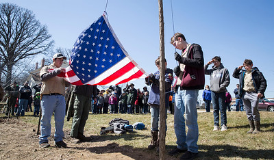 Boy Scouts Eddie Solis (left) and Wyatt Bergbreiter, both13 from Marengo with Troop 153, raise the US Flag during opening ceremonies for the third annual Scouting Around at Colonel Palmer House on Saturday, April 7, 2018 in Crystal Lake, Illinois. The program is a free annual event run by the Crystal Lake Park District celebrating the youth in the community giving scouts from across McHenry County an opportunity to share skills they learn in their programs with the community. John Konstantaras photo for Shaw Media