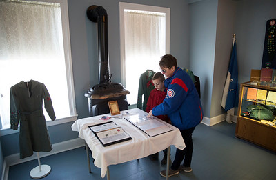 Joyce Malek, from Oakwood Hills, looks over a historic girl scout display with her son Ryley, 7 with Cubs Scout Pack 156, in the Colonel Palmer House during the third annual Scouting Around on Saturday, April 7, 2018 in Crystal Lake, Illinois. The program is a free annual event run by the Crystal Lake Park District celebrating the youth in the community giving scouts from across McHenry County an opportunity to share skills they learn in their programs with the community. John Konstantaras photo for Shaw Media