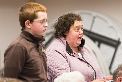 Whitney Rupp for Shaw Media Molly Pack and son Charlie Pack, 12,  speak at the Algonquin Township annual town meeting Tuesday, April 10.