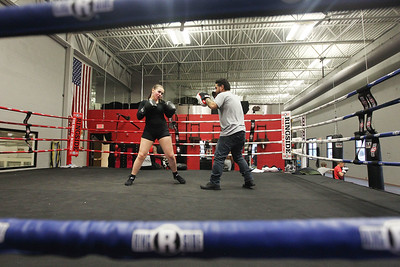 Candace H. Johnson-For Shaw Media Bella Crothers, 16, of Grayslake works with her coach, Angel Lopez, of Waukegan on training to fight in the Chicago Golden Gloves Finals at Cicero Stadium on April 13th at the Conquer Fight Club located inside the Libertyville Sports Complex.(4/5/18)