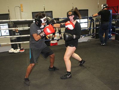 Candace H. Johnson-For Shaw Media Bella Crothers, 16, of Grayslake (on right) spars with Jeremiah Hernandez, 13, of Vernon Hills as she trains to fight in the Chicago Golden Gloves Finals on April 13th in Cicero at the Conquer Fight Club located inside the Libertyville Sports Complex.(4/5/18)